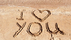 Inscription I love you on sand. Stock Footage