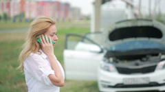 Woman and broken car calling for help on cell phone. broken car on the road Stock Footage