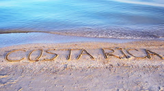 Costa Rica the inscription on the sand Stock Footage