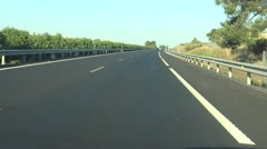 4K Car drives on freeway direction to Doñana National Park, natural reserve-Dan Stock Footage