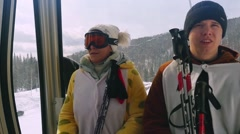 Family in sunglass mask, rises to the top in the cabin cable car at the ski Stock Footage
