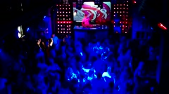DJ entertains the crowd on the dance floor Stock Footage