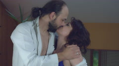 4k Morning Shot of a Sexy Couple Kissing and Hugging in Bed Arkistovideo