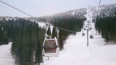 Ski cabins, resort in mountains in slowmotion, Siberia 1920x1080 Stock Footage