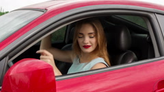 Lady with red lips dancing on a driver seat Stock Footage