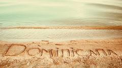 Dominicana the inscription on the sand Stock Footage