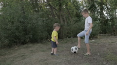 Two boys playing with a ball Stock Footage