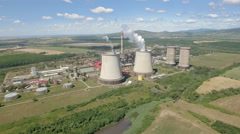 Aerial view of thermal power plant - cooling towers and chimney  Stock Footage