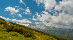 Clouds over the Alps. Time Lapse UHD Stock Footage