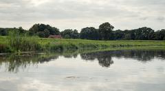 Dutch river de Berkel with dyke and farm. Achterhoek. Gelderland. The Netherl Stock Photos