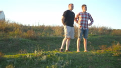 Father and son spend time together at nature in evening Stock Footage
