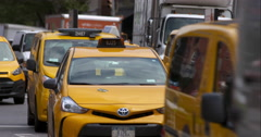 New York City taxi cabs weaving through traffic Stock Footage