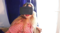 Woman with red lips testing a virtual reality glasses and smiling Stock Footage