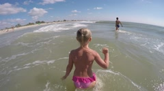 Children playing in the sea waves Stock Footage
