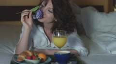 4k Morning Shot of a Sexy Woman Smelling Flower and Having Breakfast in Bed Stock Footage