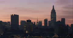 New York City skyline at sunset featuring Empire State and Chrysler building Stock Footage