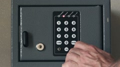 Man opening safety deposit box in hotel Stock Footage