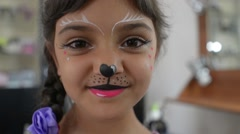 Bodyart makeup for Carnival and Halloween for little girl Stock Footage