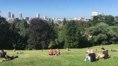 Zoom Out Crowd In Famous Parc Des Buttes Chaumont In Paris Stock Footage