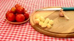 Time lapse of garlic pealing on wooden plate Stock Footage