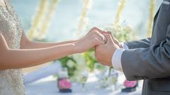 Man & Woman holding hands in wedding ceremony. Hand in hand. Stock Photos