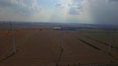 4K HD Wind turbines farm field aerial ecological technologies renewable energy Stock Footage