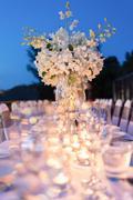 Romantic dinner setup, decoration with candle light. Selective focus. Stock Photos
