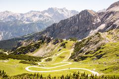 Hiking path in the alps Stock Photos