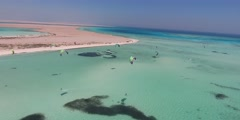 Kitesurfing in Egypt on the summer sea. Many surfers learn to ride, take aerial Stock Footage