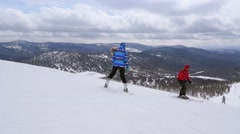 Russia, Sheregesh, 26 march 2015, People skiing and snowboarding on a slope at Stock Footage