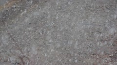 Snow falls to ground and melts Stock Footage