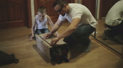 Father and son unpacking a cradle Stock Footage