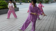 Chinese older women practicing Tai Chi Stock Footage