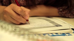 A woman studies and she thinks about answer of quiz Stock Footage