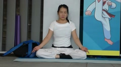 Chinese women practice yoga Stock Footage