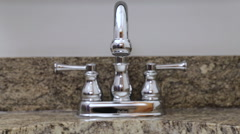 New silver water faucet in a sink, high pressure Stock Footage