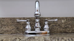 New silver water faucet in a sink, low stream Stock Footage