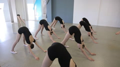 Ballerinas do exercise for straightening at beginning of ballet lesson Stock Footage