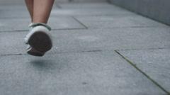 Shot of Women Legs in Sneakers Walking on Tile Road. Urban Environment. Stock Footage