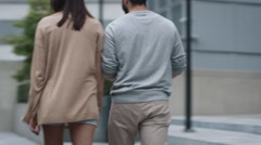 Follow Shot of Young Woman And Man are Walking and Talking in Urban Environment. Stock Footage