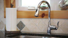 Water faucet over kitchen sink, light drip Stock Footage