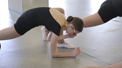 In model school women are stretching doing exercises Stock Footage