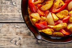 Traditional jalfrezi chicken Indian culture spicy meat and vegetables food Stock Photos