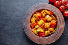 Chicken jalfrezi Indian traditional fried spicy curry chilli meat and vegetables Stock Photos
