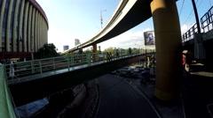 People walking on complex elevated walkway Stock Footage