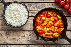 Chicken jalfrezi dietetic traditional Indian curry spicy fried meat with Stock Photos