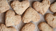 Love cooking idea, heart cookies on a wooden brown background Stock Footage