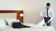 Businessman Packing Suitcase in Hotel Room Arkistovideo