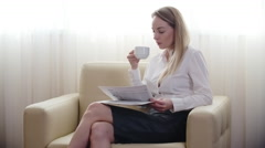 Businesswoman Relaxing in Hotel on Business Trip Stock Footage