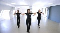 Three young models synchronously start moving in dance class Stock Footage
